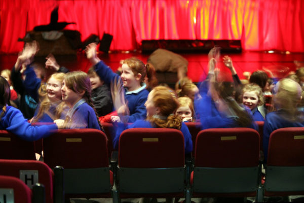 School children attending a performance at An Grianán Theatre. Photo by Declan Doherty.
