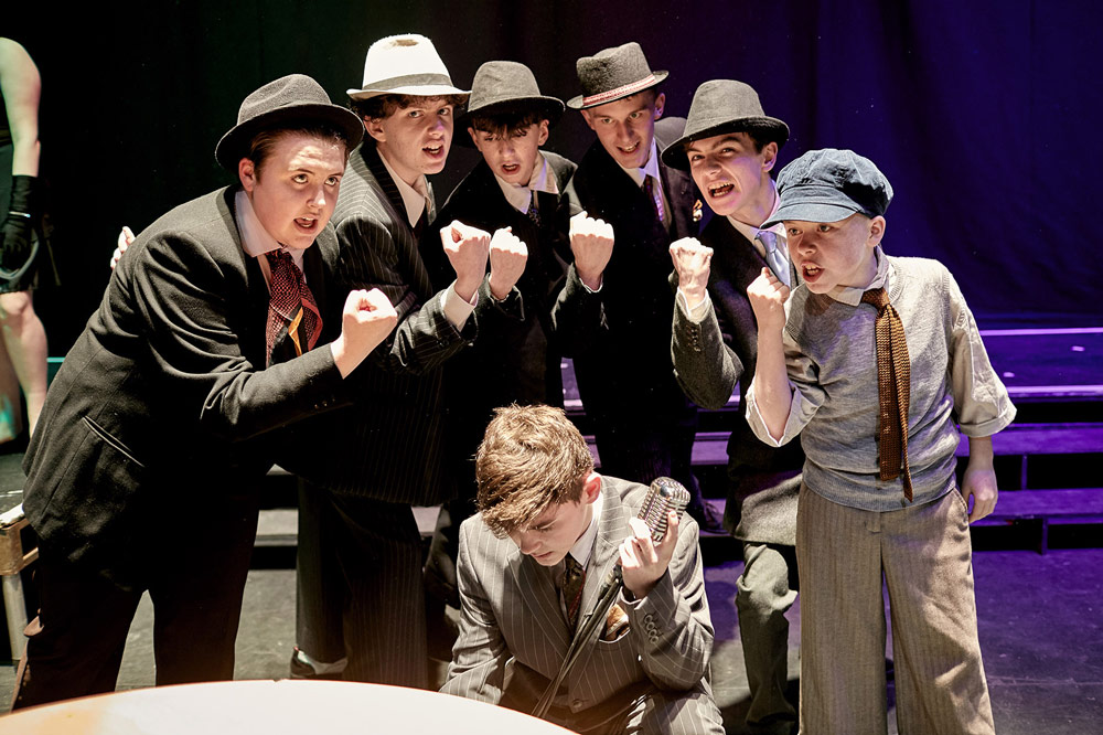 Fat Sam's Gang. A scene from An Grianán Youth Theatre/On Cue Academy production of Bugsy Malone, Jan 2020. Left to right - Amy Doherty, Darragh Ramsay, Rudi Murphy Brown, Patrick McCormack, Isaac Morrison, Ethan Barron and (crouching) Evin O'Donnell. Photo by Paul McGuckin. All rights reserved.
